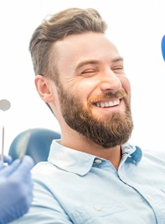 Man smiling at dentist office