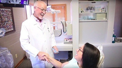 dentist shaking patient's hand