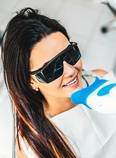 woman getting in office whitening