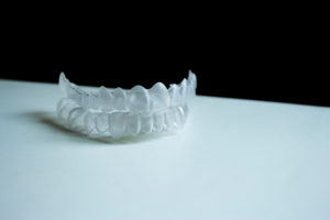 Invisalign aligners on table