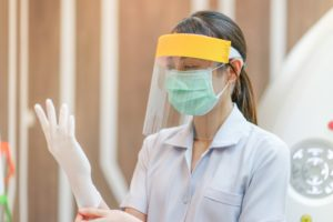 Topeka and Silver Lake dentist wearing PPE prepares for appointment in COVID-19